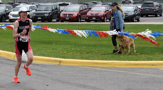 Rebecca Youngberg closes in on the finish line Saturday at the 37th Annual Apple Duathlon. She took first in 1 hour, 35 minutes. 43.25 seconds in the race that finished at Sartell Middle School.