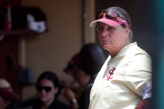 Head Coach Lonni Alameda fights back tears after the Florida State Seminoles fall to the Oklahoma State Cowgirls in the final game of Super Regionals Saturday, May 25, 2019.