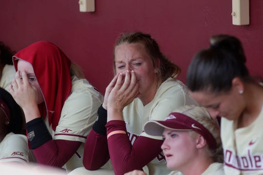 Florida State Seminoles starting pitcher/relief pitcher Meghan King (48) fights back tears after playing her final game as a Seminole. The Florida State Seminoles fall to the Oklahoma State Cowgirls in the final game of Super Regionals Saturday, May 25, 2019.