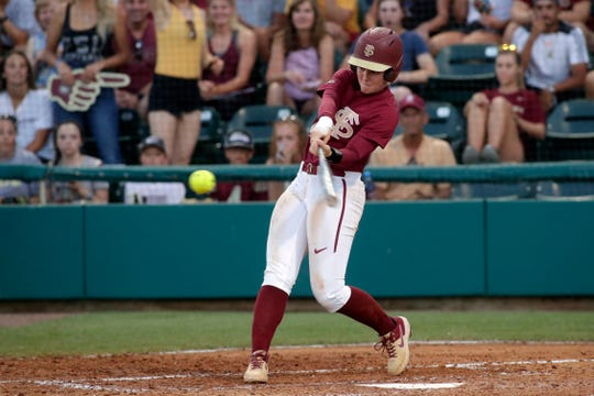 Florida State Seminoles utility player Sydney Sherrill (24) swings at the pitch. The Florida State Seminoles face off against the Oklahoma State Cowgirls in the second game of Super Regionals Friday, May 24, 2019.