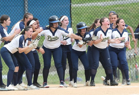 Walter Panas players wait at home for the arrival of teammate  Sam Kayo after she hit  a 2-run homer in the 7th inning against Hen Hud during softball playoff action in Montrose May 25, 2019. Panas won the game 4-1.