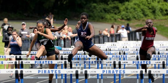 Pleasantville's Isabelle Kapoor and Eastchester's Alya Campbell compete in the girls 100 meter hurdles during the Section 1 Class B Track & Field Championships at Pearl River High School, May 25, 2019.  Campbell fell, causing Kapoor to also fall and both were disqualified from the race. At right is winner Ashia Kapio from Harrison.