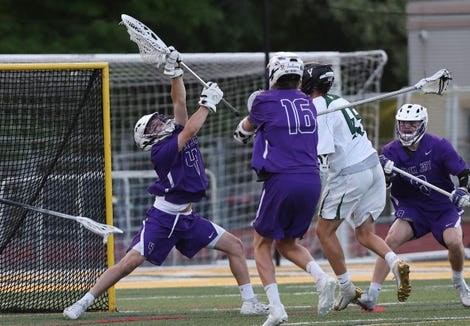 John Jay goalie Jack Browne (4) makes a save on a shot from Yorktown's Blake Borges (45) during the Section 1 Class B championship game at Lakeland High School in Shrub Oak May 24, 2019.  John Jay won the game 7-6.