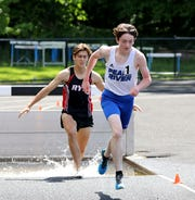 Jack Reynolds from Pearl River and Bradley Squarek from Rye, compete in the boys 3000 meter steeplechase at the Section 1 Class B Track & Field Championships at Pearl River High School, May 25, 2019.