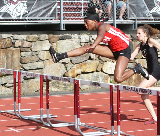 Gabrielle Brown of Hamilton winning the girls 100 hurdles at the Section 1 Class C championships at Valhalla High School on May 24, 2019.