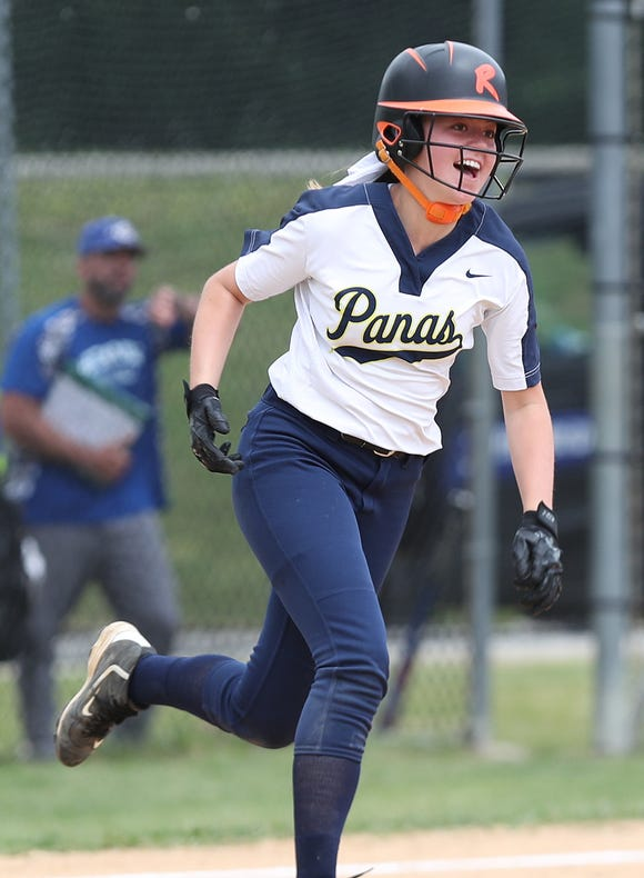 Walter Panas' Sam Kayo is all smiles as she rounds the bases after hitting a 2-run homer in the 7th inning against Hen Hud during softball playoff action in Montrose May 25, 2019. Panas won the game 4-1.