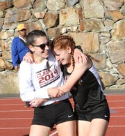 Valhalla's Diana Santini (right) celebrates with Julianne Pisacane after winning the girls 400 hurdles at the Section 1 Class C championships at Valhalla High School on May 24, 2019.