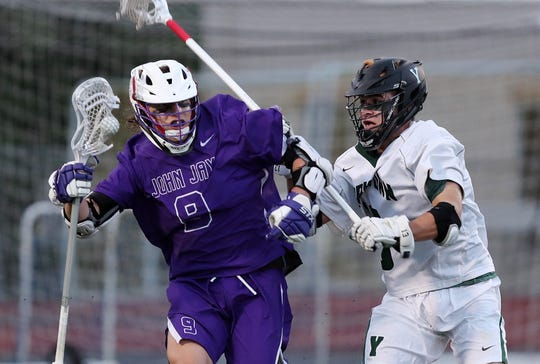 John Jay's Bryce Ford (9) tries to get around Yorktown's Keith Boyer (13) during the Section 1 Class B championship game at Lakeland High School in Shrub Oak May 24, 2019.  John Jay won the game 7-6.
