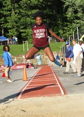 Makayla Dorvil of Albertus Magnus wins the girls triple jump at the Section 1 Class C track championships at Valhalla High School on May 24, 2019.