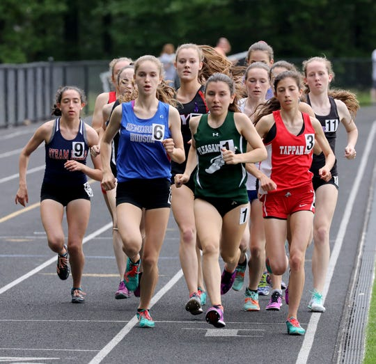 Pleasantville's Adriana Catalano leads the pack in the girls 1500 meter run, during the Section 1 Class B Track & Field Championships at Pearl River High School, May 25, 2019.