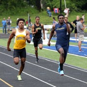 Ardsley's Jalen Osbourne (l), who'll run and play football for Ithaca College next year, races against Lourdes Jaheim Jones (r), now of Kent State, May 25 2019 in the Section 1 Class B Track & Field Championships at  Pearl River High.