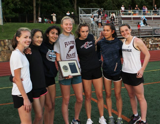 Bronxville celebrates winning the girls team championship at the Section 1 Class C championships at Valhalla High School on May 24, 2019.