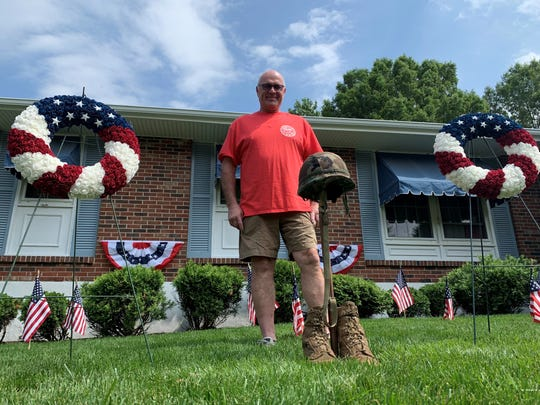 Bill Smith decorates his Pike Creek lawn every Memorial Day with flags, wreaths, banners and a shrine to fallen soldiers.