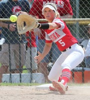 Smyrna first baseman Julia Thuer waits on the throw to complete a double play and end Smyrna's 1-0 win over Caravel in the DIAA Softball Tournament title game Saturday.