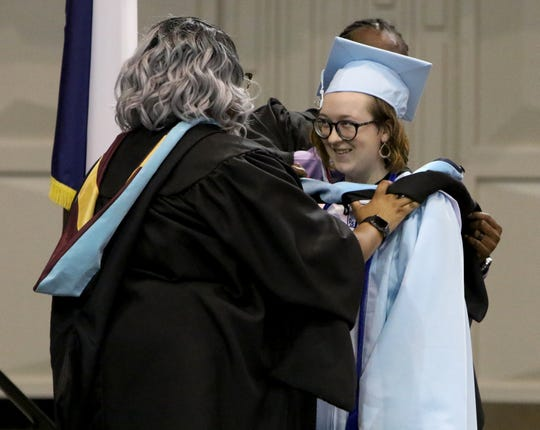 Hirschi international baccalaureate graduates are hooded at graduation May 25, 2019, in Kay Yeager Coliseum.