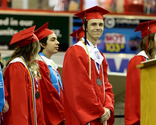 Wichita Falls High School honor graduates stand on the stage at the 128th commencement May 25, 2019, in Kay Yeager Coliseum.