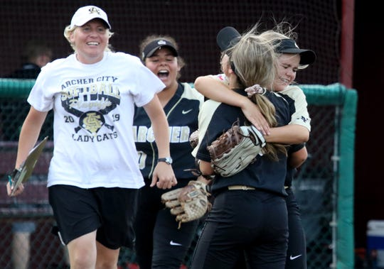 Archer City sisters Victoria, left, and Vanessa Rater hug after their in Gm 2 win over Windthorst Friday, May 24, 2019, at Midwestern State University's Mustangs Park. The Lady Cats defeated the Trojanettes 5-4 to force a third game.
