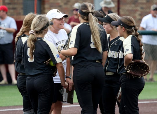 Archer City head softball coach Mallory Mooney talks with her player during a timeout in Gm 2 against Windthorst Friday, May 24, 2019, at Midwestern State University's Mustangs Park. The Lady Cats defeated the Trojanettes 5-4 to force a third game.