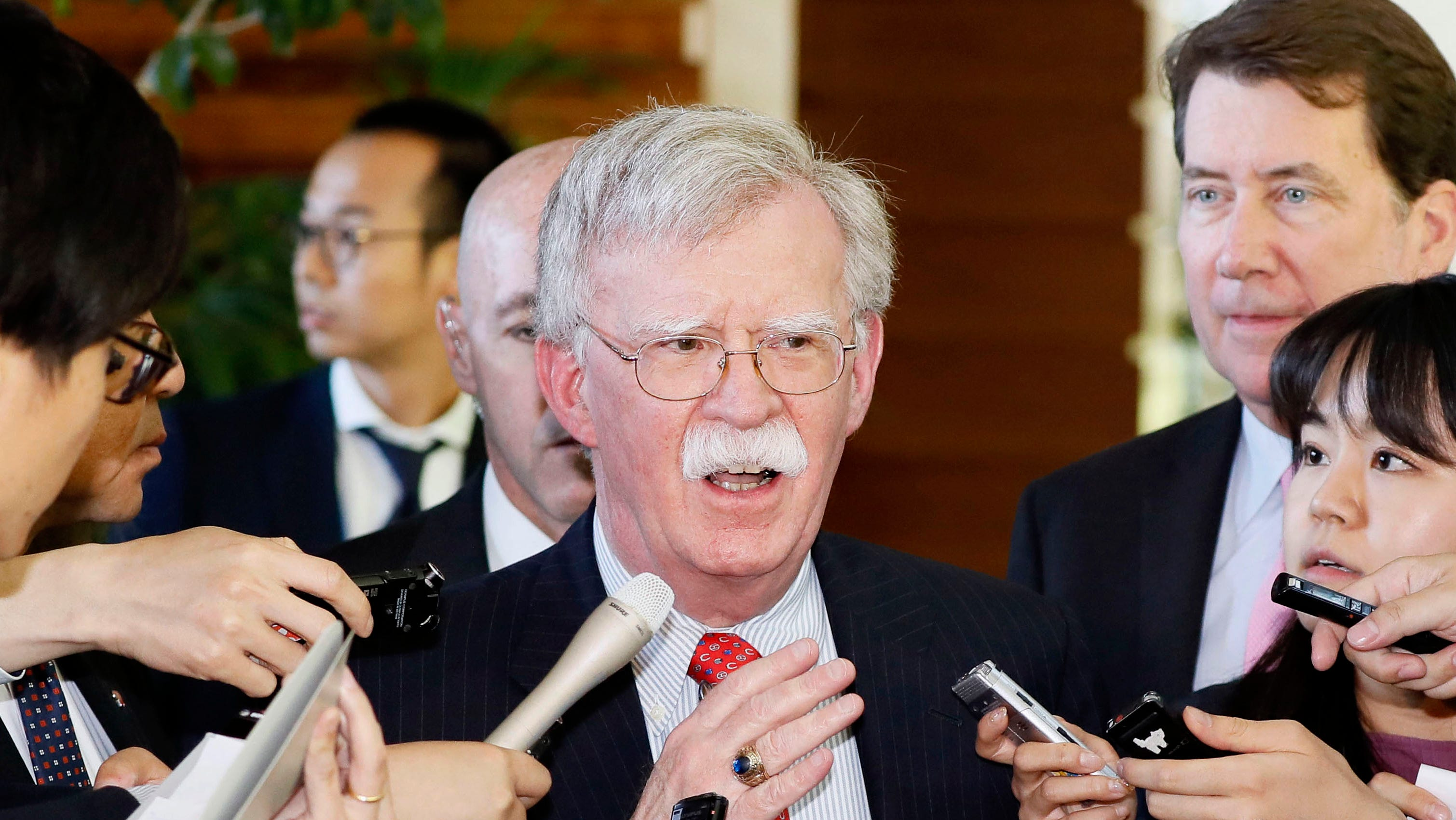 In this Friday, May 24, 2019, photo, U.S. National Security Adviser John Bolton is surrounded by reporters at the prime minister's official residence in Tokyo. Bolton called a series of short-range missiles launched by North Korea last month were violations to U.N. Security Council resolutions, stressing the need to keep sanctions in place. Bolton said Saturday, May 25, 2019, in Tokyo the U.S. position on the North's denuclearization is consistent and that a repeated pattern of failures should be stopped.