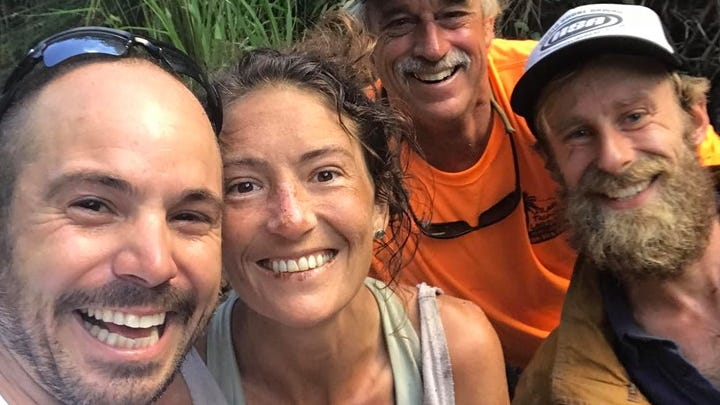 This photo taken by Javier Cantellops, shows Amanda Eller, along with other searchers Chris Berquist and Troy Helmers after she was found in Makawao Forest Reserve on Maui, Hawaii, on May 24.