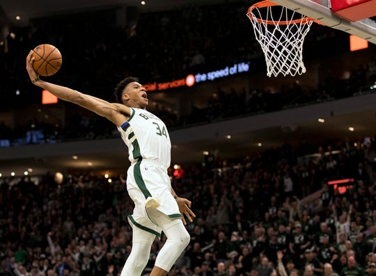 Milwaukee Bucks forward Giannis Antetokounmpo dunks.