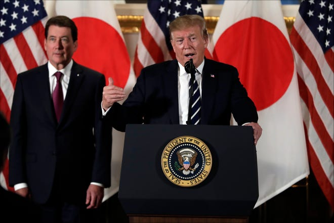 President Donald Trump speaks with Japanese business leaders Saturday, May 25, in Tokyo as U.S. Ambassador to Japan William Hagerty listens.