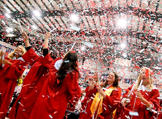 Confetti fills the air as Chisholm High School Class of 2019 celebrates after commencement at the Chisholm Trail Expo Center in Enid, Okla. Saturday, May 18, 2019.