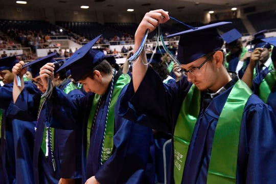 "Students from the Academy of Technology, Engineering, Math and Science class of 2019 flip their tassels during commencement. While the coronavirus is putting a damper on current seniors forced to stay away from friends, the district is promising an in-person graduation ceremony ""even if it's in the middle of July,"" Superintendent David Young said."