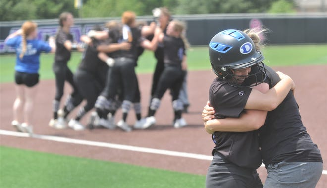 Decatur coach Carly Cloud, right, hugs Rylen Chapa while the rest of the team celebrates after Chapa scored the game-winning run on J.T. Smith's ground out in the bottom of the seventh inning. Chapa's run lifted the Lady Eagles to a 2-1 victory over Andrews and a sweep of the Region I-4A final series Saturday, May 25, 2019, at ACU's Poly Wells Field.