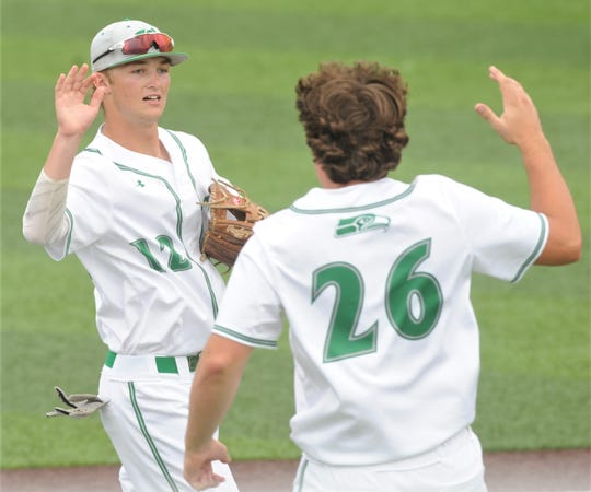 Wall shortstop Ryan Gully (12) celebrates with Trace Briley after Gully made a nice play on Aaryn Medina's ground ball deep in the hole at short to end the fourth inning with two runners on base. Wall beat Breckenridge 11-1 in five innings to sweep the Region I-3A semifinal series Saturday, May 25, 2019, at ACU's Crutcher Scott Field.