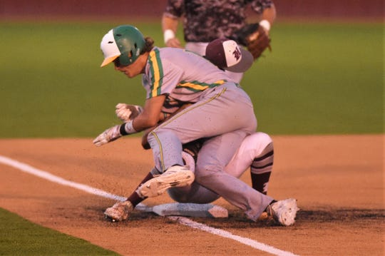 Hawley's Robert Ybarra has hit hat knocked off as New Deal's Layton Reed runs him over during Game 3 of the Region I-2A semifinal series against New Deal in Lockney on Saturday, May 25, 2019. The Bearcats ended their season with a 4-3 loss.