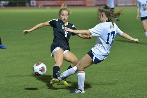 T.C. Roberson's Caroline Addison (17) kicks the ball against East Chapel Hill's Kate Sheslow (5) during the first half. The T.C. Roberson Rams and the East Chapel Hill Wildcats met in the NCHSAA 3A Women's soccer finals at N.C. State in Raleigh, N.C. on May 25, 2019.