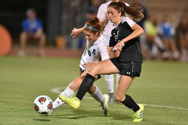 T.C Roberson's Emily Bankhard (6) and East Chapel Hill's  Sarah Jooste (26) battle for control of the ball during the first half. The T.C. Roberson Rams and the East Chapel Hill Wildcats met in the NCHSAA 3A Women's soccer finals at N.C. State in Raleigh, N.C. on May 25, 2019.