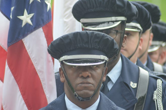 Sgt. Anthony Woodruff prepares to lead the Honor Guard from the Battle Creek Air National Guard Base to begin the Memorial Day Service on Sunday.