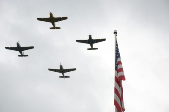 The Civil Air Patrol's Hooligan Flight Teams passes over the cemetery