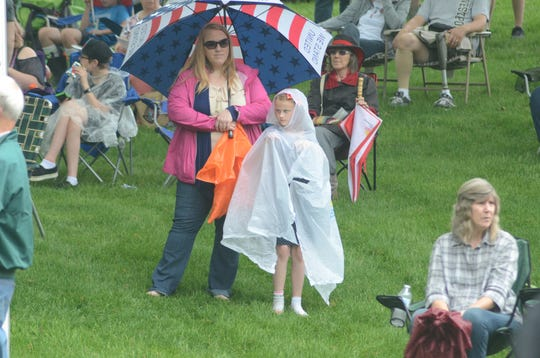 Christine LeBrun and daughter, Allison, 8, of Diamondale needed some protection from the rain.