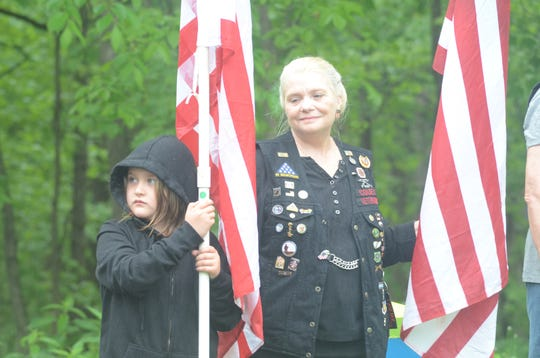 Maresa Scroggins, 6, of Springfield, and Sandy Morgan of Battle Creek were part of the Patriot Guard at the ceremony.