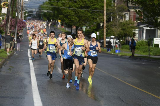 Top men's runners led by  Eric Ashe compete in the Vermont City Marathon on Sunday, May 26, 2019.