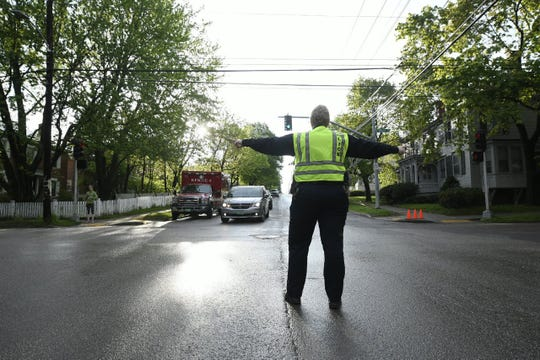 Burlington Police Department Deputy Chief Jan Wright directs traffic at South Willard and Pearl streets before the start of the Vermont City Marathon on Sunday, May 26, 2019.