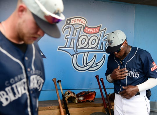 Hooks' Seth Beer, left, and Ronnie Dawson pause before the game against the Frisco Rough Riders, Saturday, May 25, 2019, at Whataburger Field.