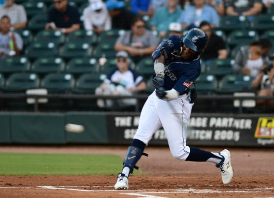 Hooks' Ronnie Dawson hits the ball at the game against the Frisco Rough Riders, Saturday, May 25, 2019, at Whataburger Field.