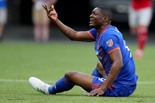FC Cincinnati forward Fanendo Adi (9) argues with a linesman with in the first half of an MLS soccer match against the New York Red Bulls, Saturday, May 25, 2019, at Nippert Stadium in Cincinnati.