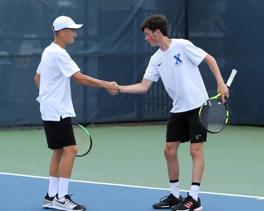 Preston Stearns and Charlie Temming congratulate each other after scoring a point in the OHSAA Division I doubles finals. Preston Stearns and partner Charlie Temming defeated Anish Gangavaram and Vignesh Gogineni 6-7, 6-3, 6-4 to win the OHSAA Division 1 Doubles Title.