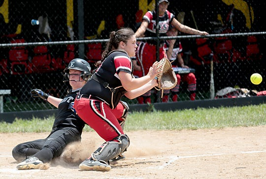 Lakota East base runner Cassidy Hudson slides home as Lakota West catcher Kendall Forren takes the throw during their Division I regional final at Centerville Saturday, May 25, 2019.