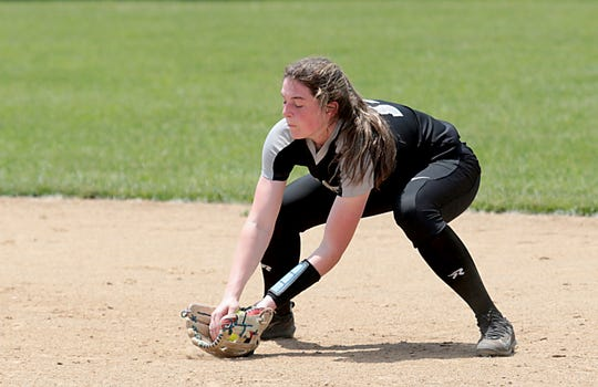 Lakota East second baseman Abby Beckham fields a Lakota West ground ball during their Division I regional final at Centerville Saturday, May 25, 2019.