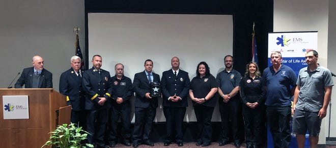 The Fairfield Fire Department was one of three in Butler County to receive the Star of Life Award. Pictured, from left, are: Chief Don Bennet, Capt. Jamison Ruhl, Air Care pilot Jeff Logeman, paramedics Chris Simpson and Jon Krueckeberg, Dispatcher Tracy Brown, Dispatch Supervisor John Meyer, Air Care nurse Jennifer Hacker, Patient Stephen Tacy, and his son, Tyler Tacy.