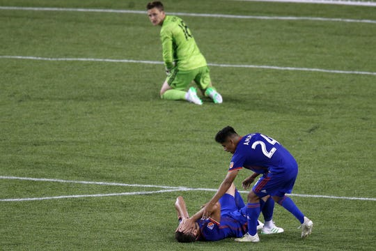 FC Cincinnati defender Mathieu Deplagne (17) reacts after losing possession resulting in the first goal of the game in the second half of an MLS soccer match against the New York Red Bulls, Saturday, May 25, 2019, at Nippert Stadium in Cincinnati. New York Red Bulls won 2-0.