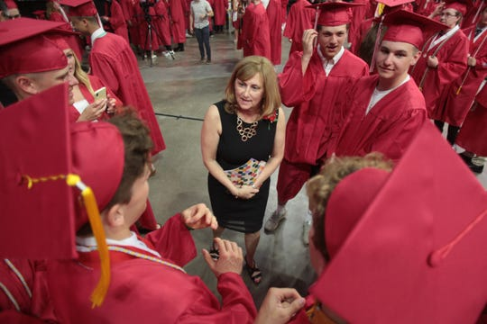 City High Language Arts teacher Robin Fields chats with students before commencement ceremonies for the Iowa City High School graduating class of 2019 at Carver-Hawkeyes Arena in Iowa City on Saturday evening, May 25, 2019.
