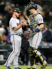 Twins pitcher Austin Adams and catcher Jason Castro greet each other after the 18-4 win over the Mariners, May 18, 2019, in Seattle.