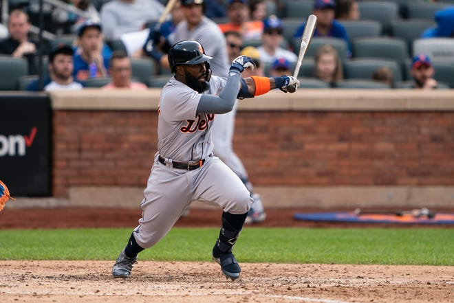 Detroit Tigers second baseman Josh Harrison hits a double during the eighth inning against the New York Mets at Citi Field, Saturday, May 25, 2019.